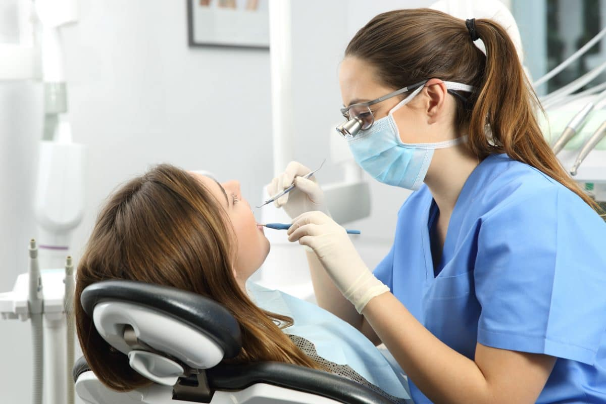 dental examination with patient